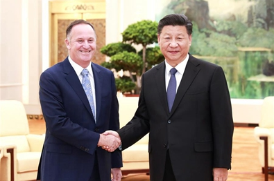 Chinese president meets former New Zealand PM John Key